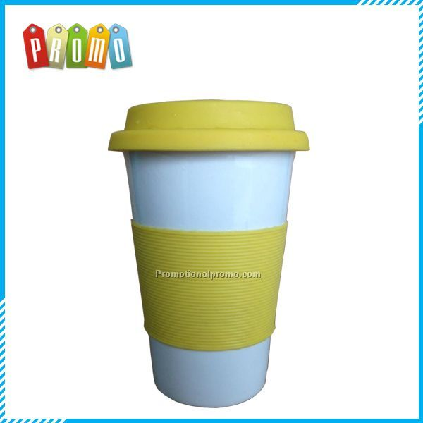 Promotional Ceramic travel mug with silicone lid and silicone removable part