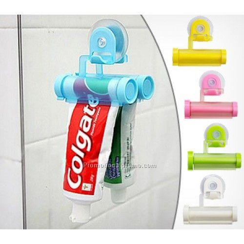 Hanging toothpaste tube squeezer with suction cup